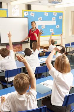 Teacher teaching a class in a primary school