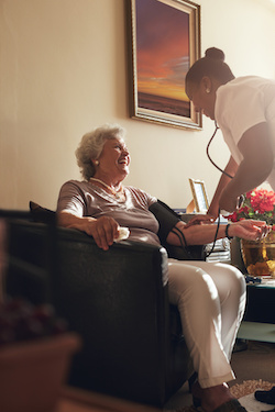 An elderly person being taken care of in a local authority care home